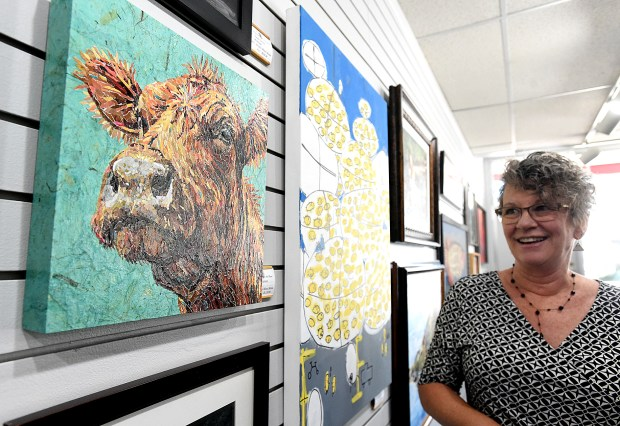 "LOVELAND, CO - SEPTEMBER 9, 2019: Jill Atchison, Director of the Lincoln Gallery, talks about a mixed-media piece titled ""Eleanor"" by artist Andi Burnum Monday, Sept. 9, 2019, on display as part of the gallery's Regional Fine Art Show in downtown Loveland. (Jenny Sparks/Loveland Reporter-Herald)"