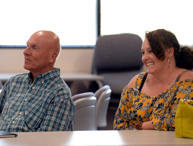 Stu Boyd, left, and Dawn Kirk listen Tuesday as the Thompson School District Board of Education members vote to cancel the upcoming election because there were no contested races. Boyd and Kirk were two of the people running uncontested. (Jenny Sparks/Loveland Reporter-Herald)