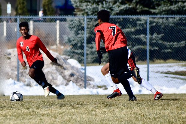 Loveland teammates Abyalew Tesfa, right, and ...