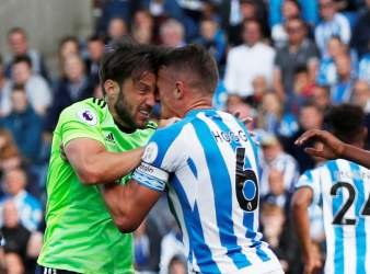 Huddersfield's Jonathan Hogg clashes with Cardiff's Harry Arter, leading to Hogg being sent off.