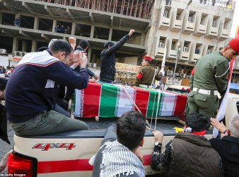 Media captionMourners surround a car carrying the coffin of Qasem Soleimani in Baghdad