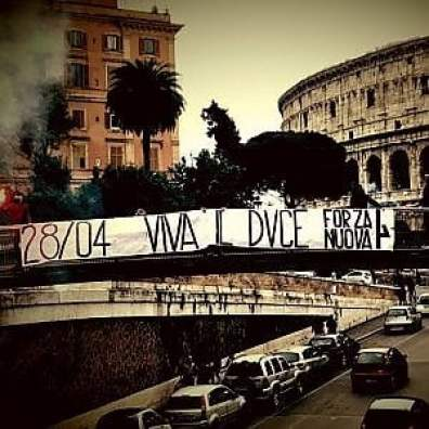 Rome, the Colosseum, check the banner of Forza Nuova in the day of the death of Mussolini