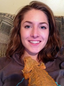 Reptile person cuddling with her bearded dragon