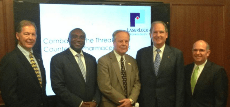 Rep. Ed Whitfield, middle, poses with LaserLock executives at an event hosted by Georgetown University