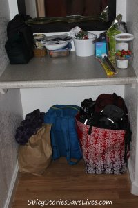 Robin has kept her motel room tidily organized, and already has her belongings packed and ready to transfer to the new duffel bag we got tonight.