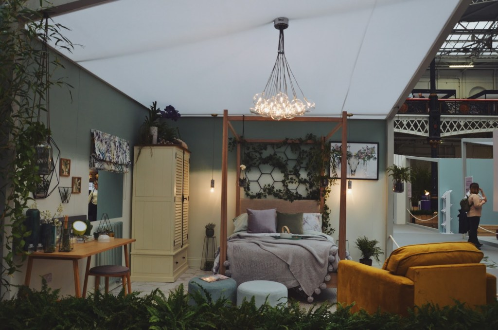 Jungle-style bedroom with a garden trellis bed frame