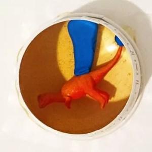 dinosaur model in mold cup