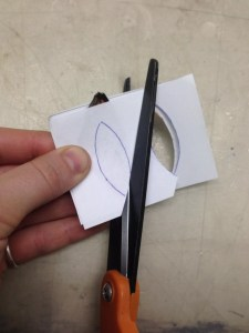 trimming paper around butterfly wings