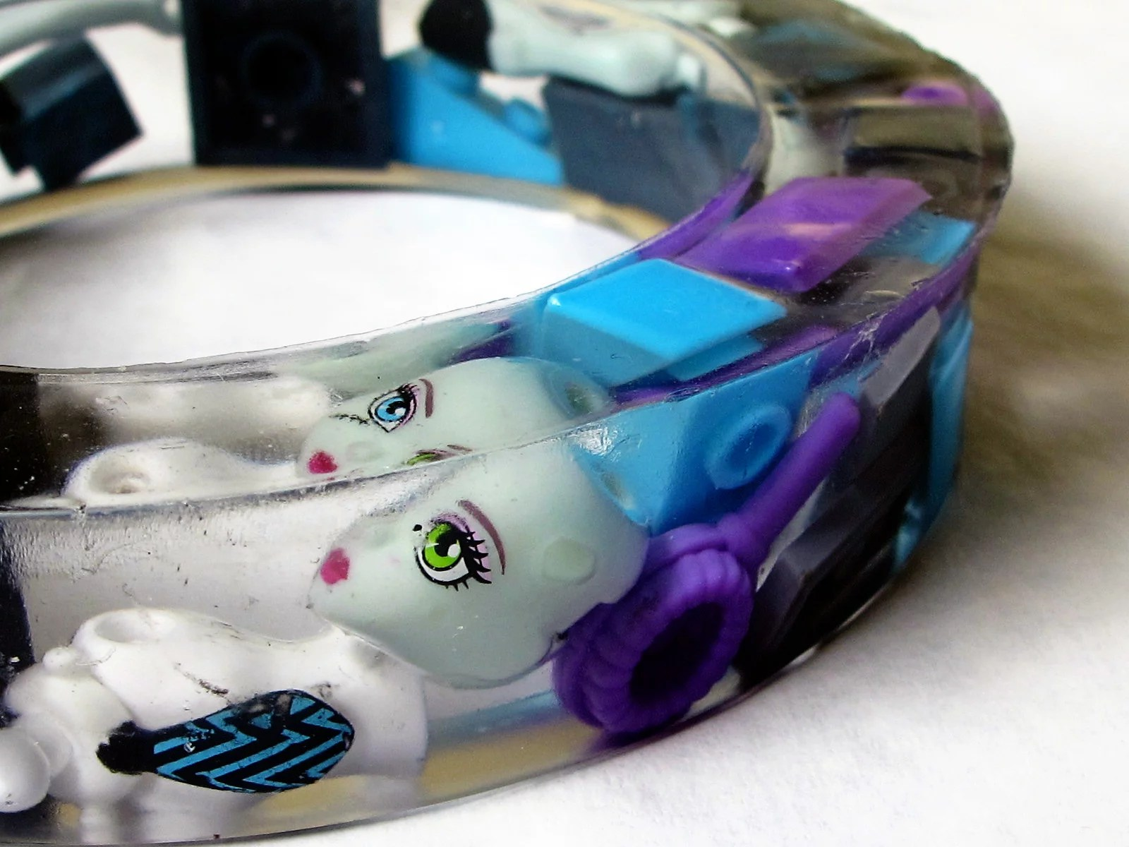 Resin bracelet with doll parts