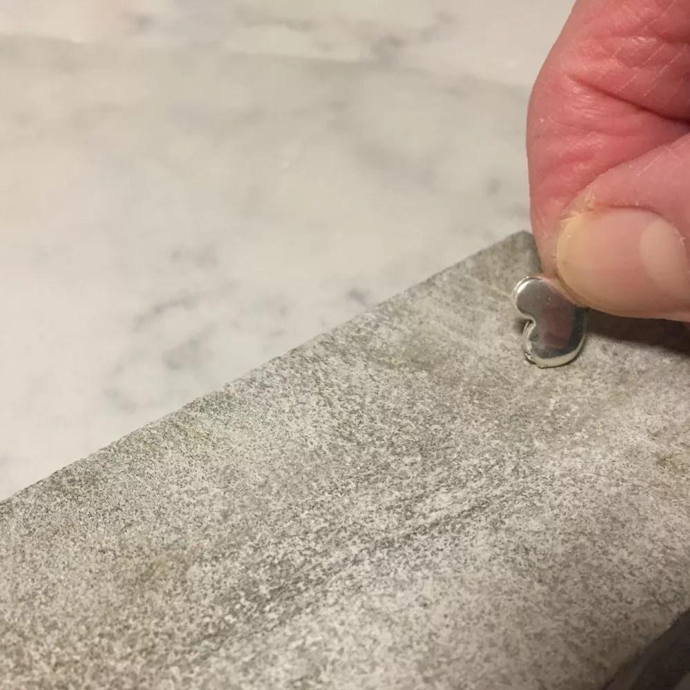sanding sharp edge off charm