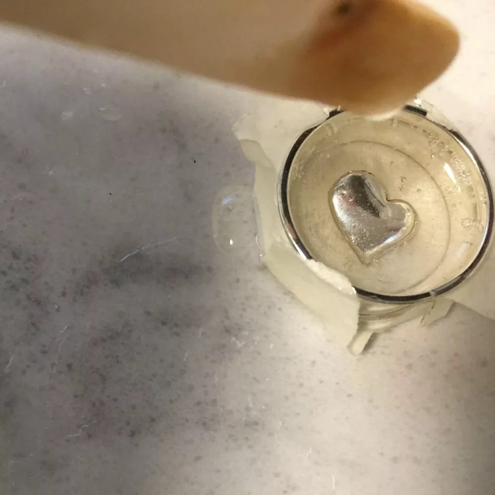 covering the charm with resin