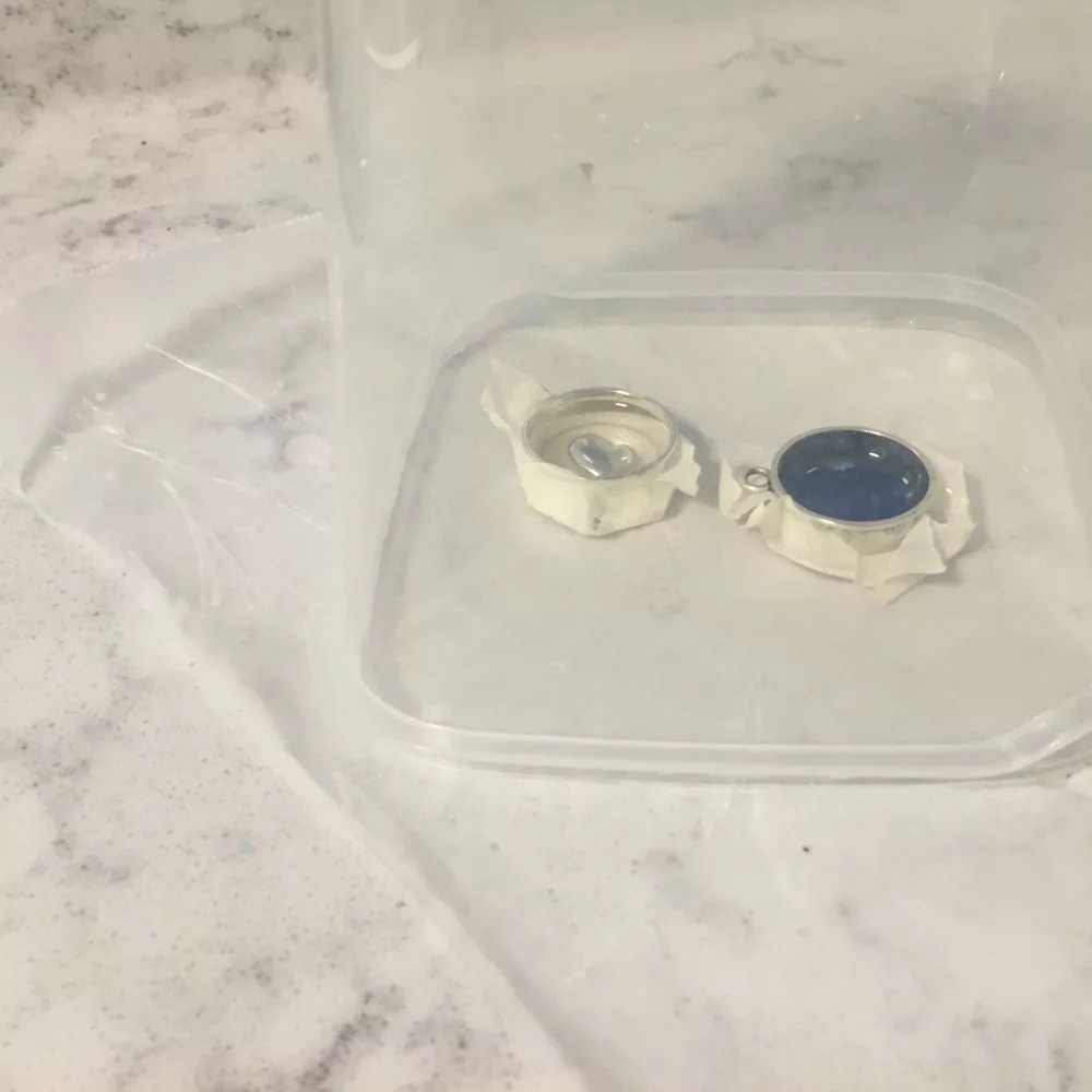 covering bezels while resin cures