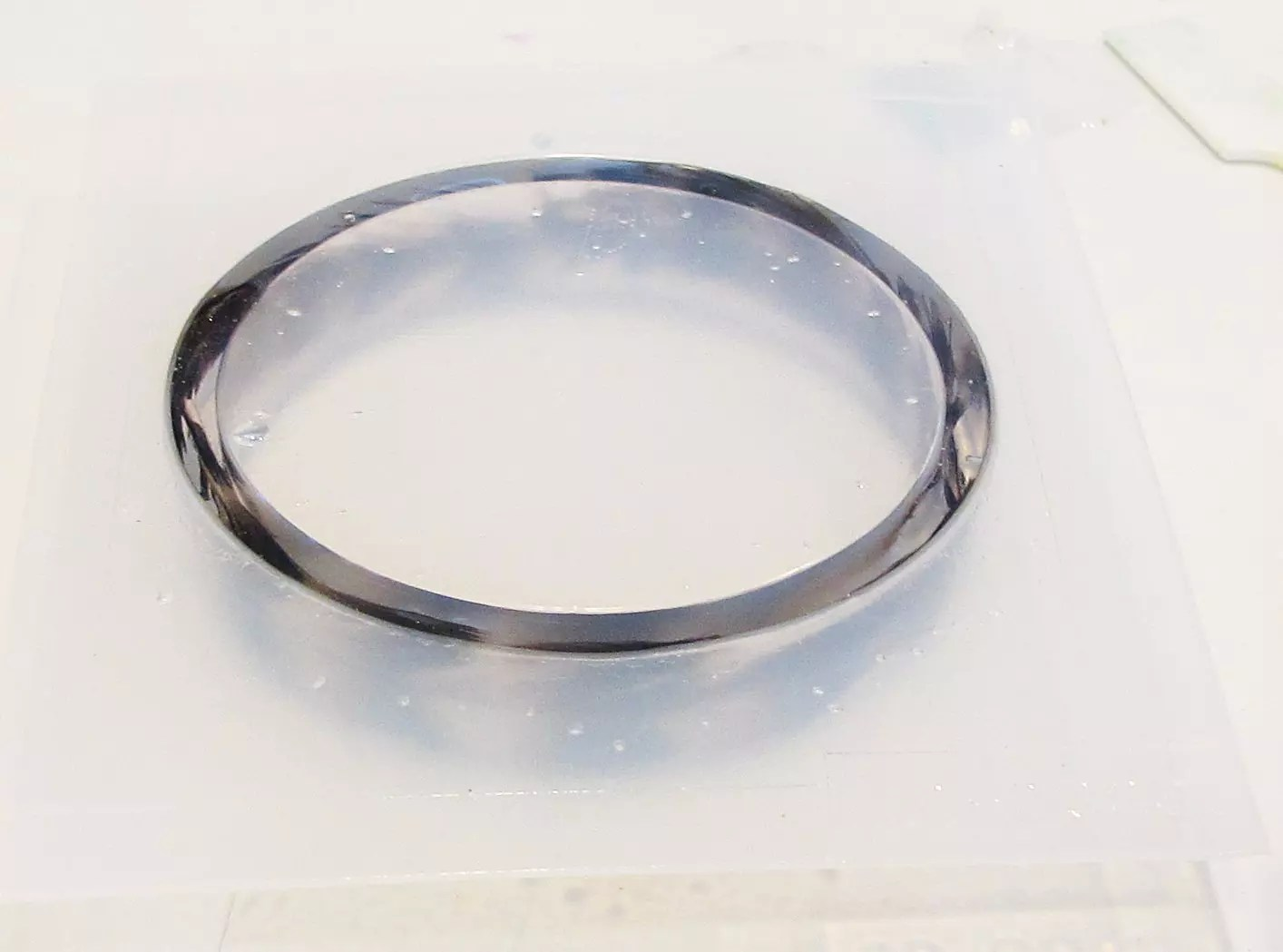 feathers in a resin bracelet mold