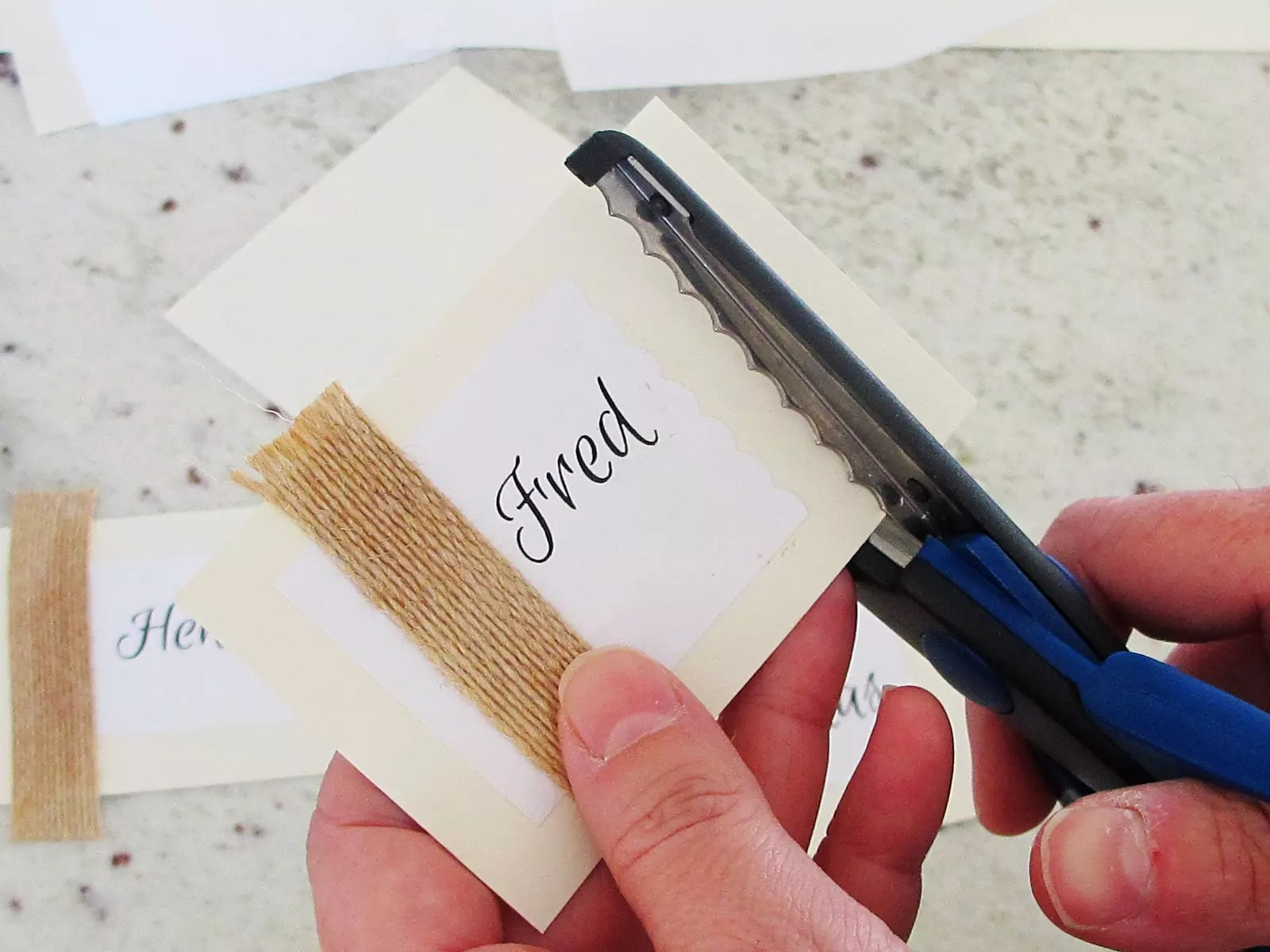 trimming edge of a place card with decorative scissors