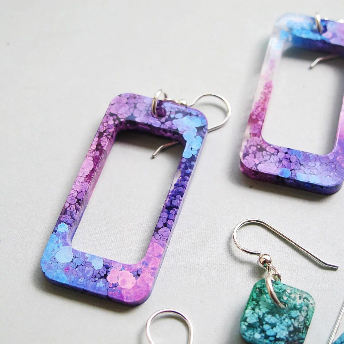 green purple and blue resin petri earrings