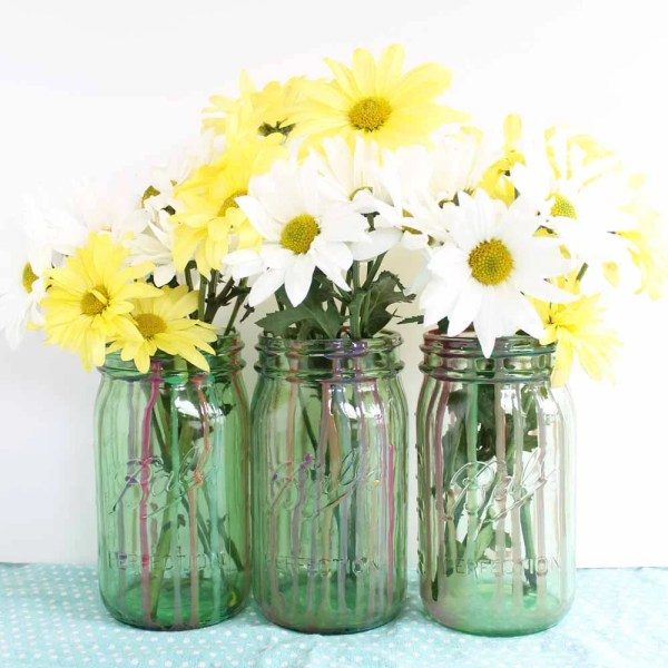 finished resin mason jar project with flowers in jars