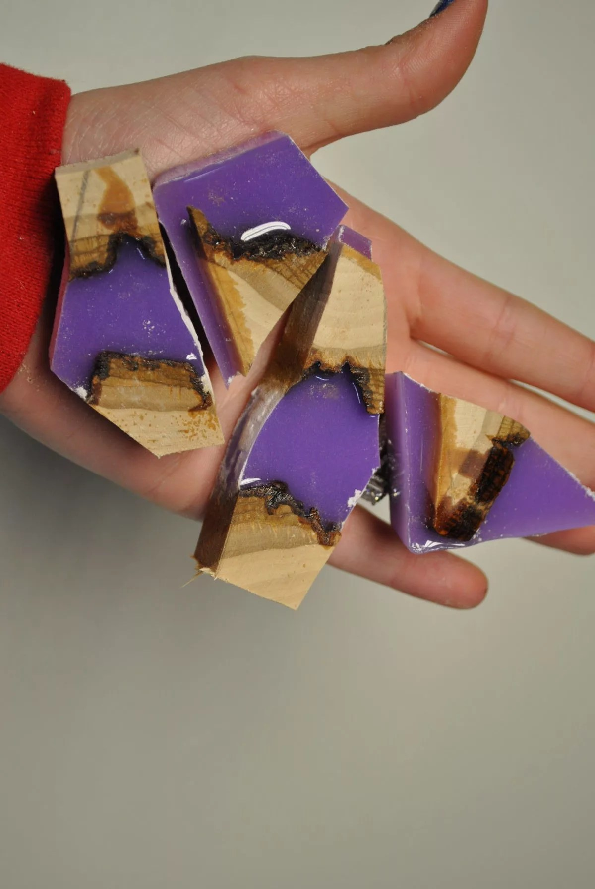 four pieces of cut wood and lavender resin
