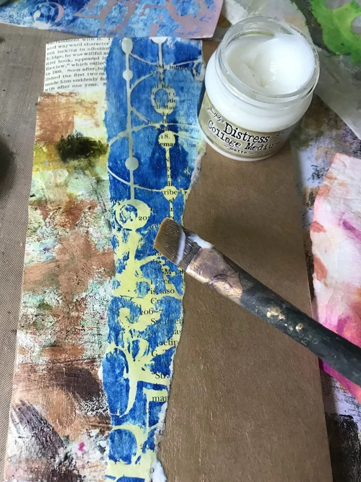 gluing down papers on journal cover