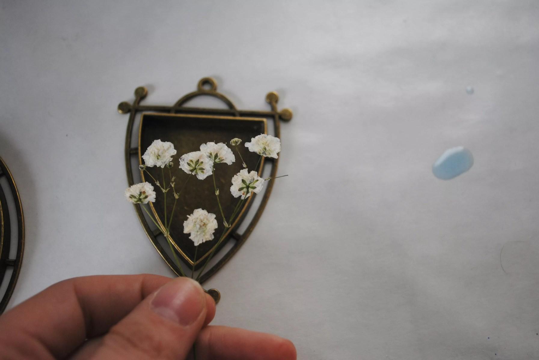flattened baby's breath inside pendant