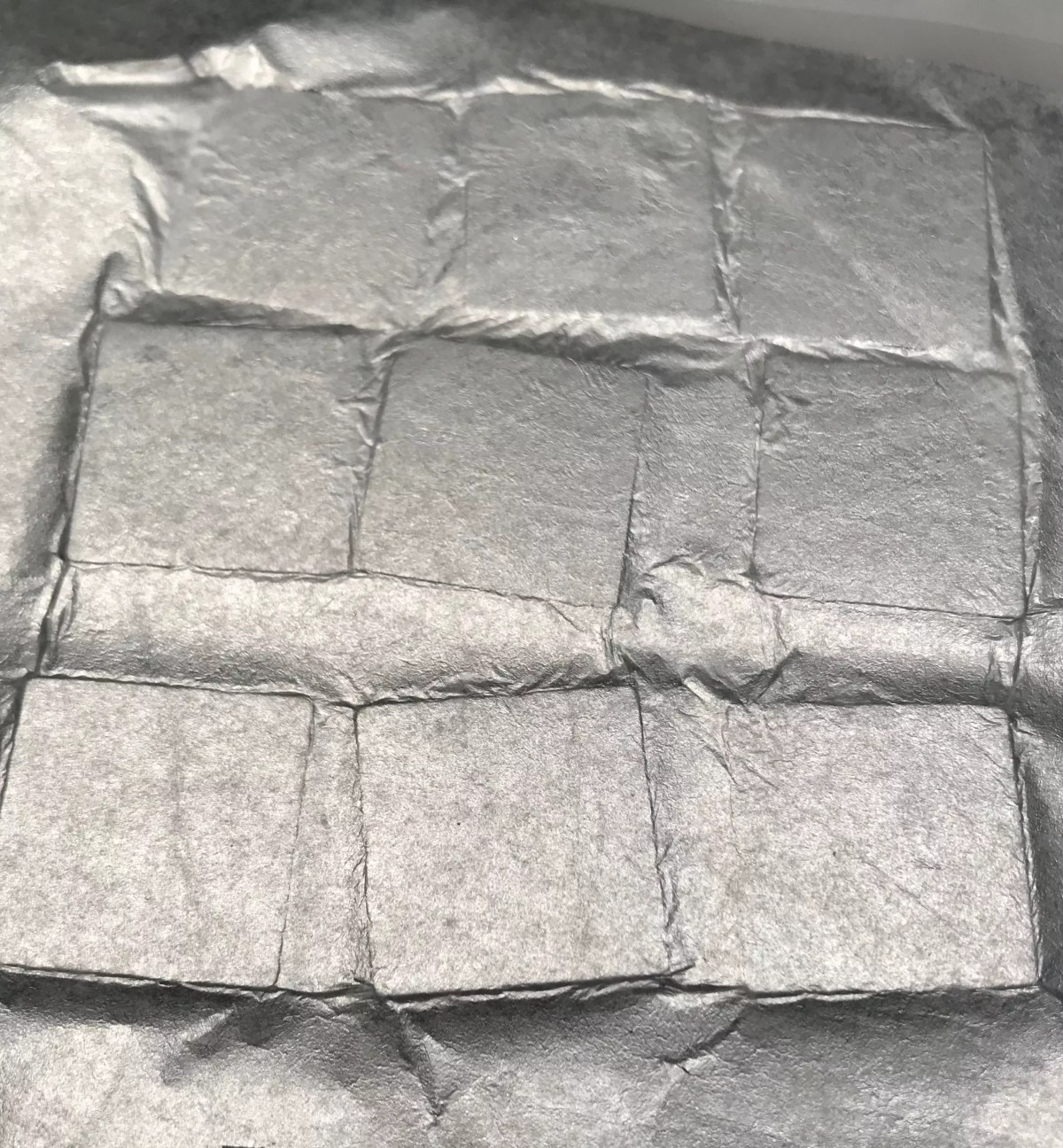 silver leafing covering wooden tiles