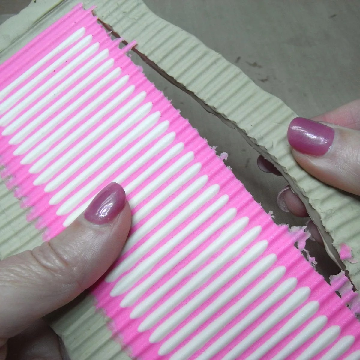 peeling away clay from resin