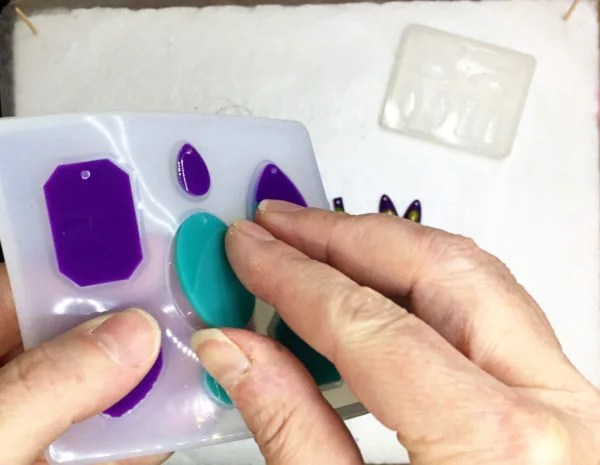 demolding resin charms from a silicone mold