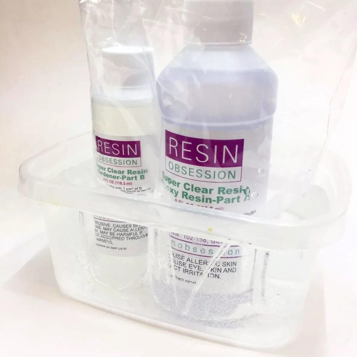warming bottles of epoxy resin in a hot water bath