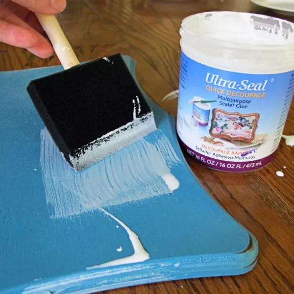 apply a layer of glue to the board