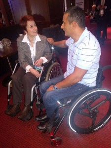 Stel Penhasov and Dror Cohen talking in their wheelchairs