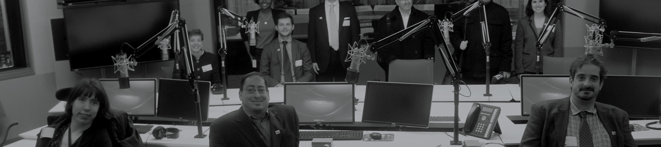 Image of people smiling in a recording studio.
