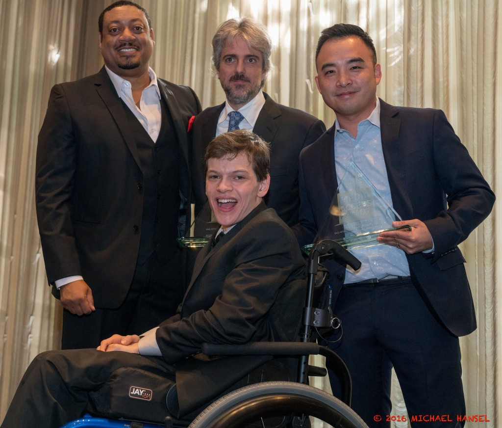 Speechless' Cedric Yarbrough, Scott Silveri, Melvin Mar and Micah Fowler smiling and posing with Silveri and Mar's award