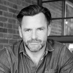 black and white headshot of Andrew Egan