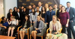 Cal Thomas and RespectAbility Fellows standing and seated in a posed photograph, smiling for the camera