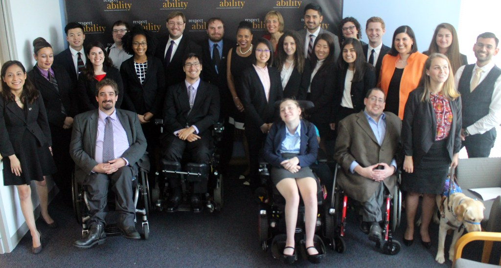 Donna Walton and RespectAbility Fellows standing and seated in a posed photograph, smiling for the camera