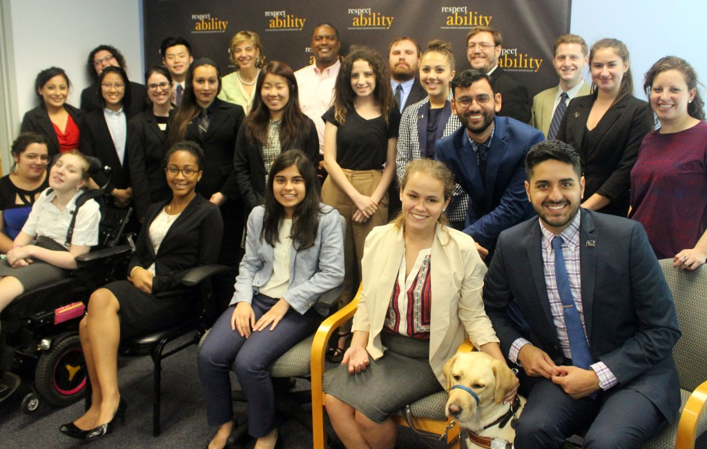Gerard Robinson and RespectAbility Fellows standing and seated in a posed photograph, smiling for the camera