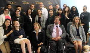 Jonathan Kessler and RespectAbility Fellows standing and seated in a posed photograph, smiling for the camera