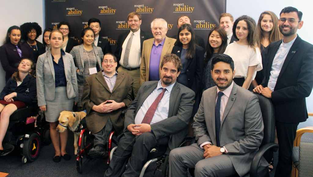 Ron Drach and RespectAbility Fellows standing and seated in a posed photograph, smiling for the camera