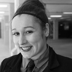 headshot of Amelia Heider wearing her hair up grayscale photo