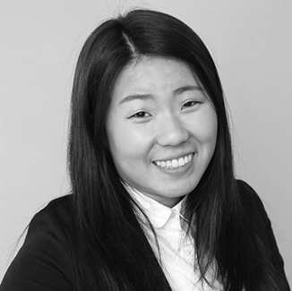 headshot of Ana Song wearing her hair loose grayscale photo
