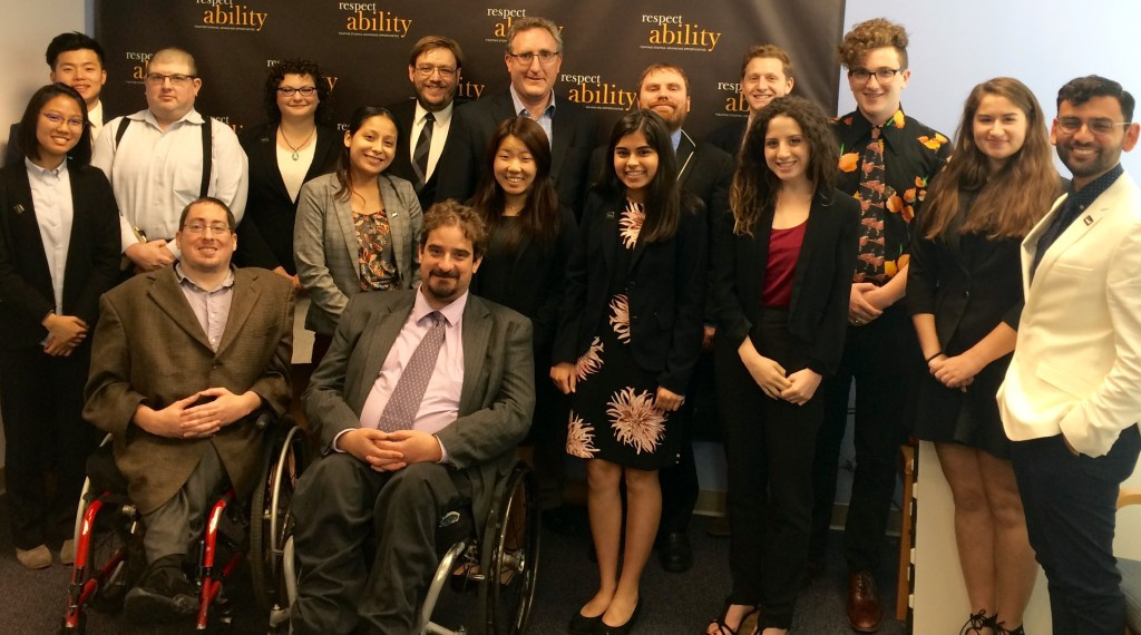 Andy Imparato and RespectAbility Fellows standing and seated in a posed photograph, smiling for the camera