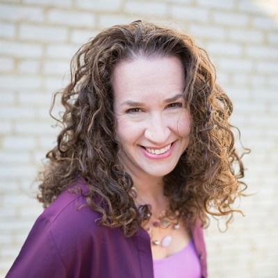 Dana Marlowe smiling and facing the camera