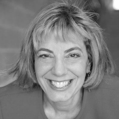 headshot of Jennifer Laszlo Mizrahi smiling and facing the camera grayscale photo