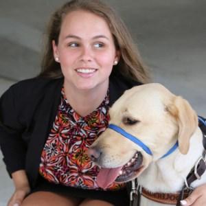 Stephanie Flynt with service dog Nala color photo