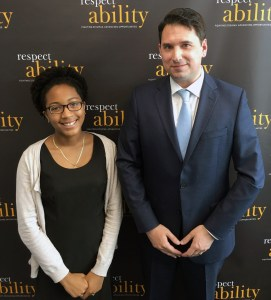 RespectAbility Fellow Brieanna Iyomahan with Geoffrey Melada posing and smiling for a photo