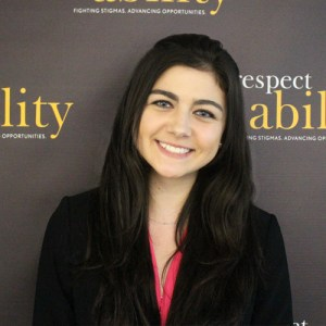 Respectability fellow Brooke Castagna smiling in front of the Respectability banner