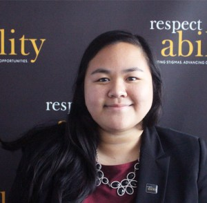 Respectability fellow Julie Lun smiling in front of the Respectability banner