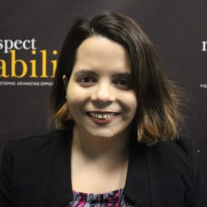 RespectAbility Policy, Practices and Latinx Outreach Associate Stephanie Farfan smiling in front of the RespectAbility banner