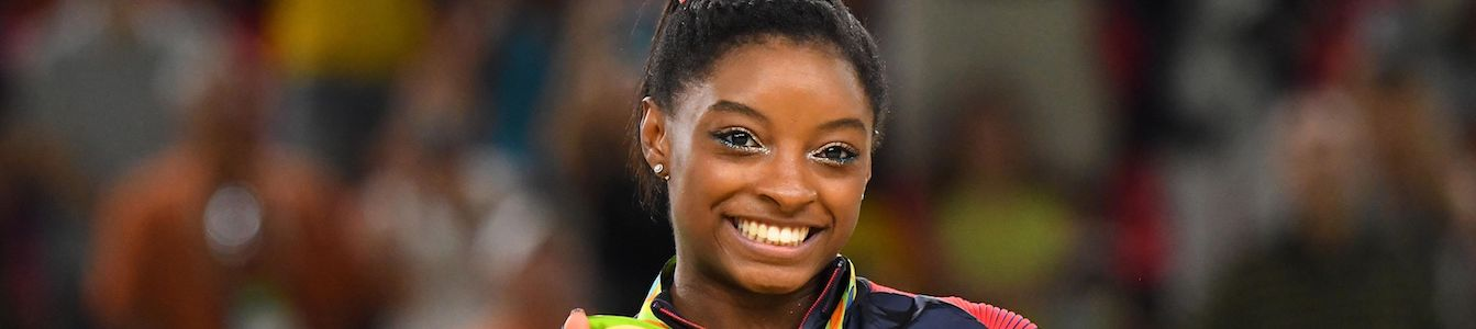 close up of Simone Biles' smiling face
