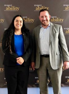 Aaron Dorfman and RespectAbility Fellow Juliet Arcila Rojas in front of the RespectAbility banner