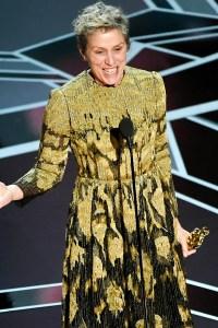 Frances McDormand holding an Oscar giving a speech on stage